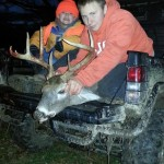Dalton Eck, 13, from Chandlerville, Ohio, and his little brother, Dallas, pose a deer taken on the family farm. The 8-point buck is Dalton's first.
