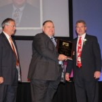 Dave Brandt (center) received the 2012 Distinguished Service Award from Ohio Farm Bureau Federation Nov. 29.