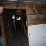"""National FFA swine winner Garrit Sproull is glad to be moving out of this old, small pig barn, and into the new barn, which still isn't completed. But as Sproull's FFA adviser Don Jones reminds Sproull and other young FFA'ers about livestock management: """"It's not about new buildings."""""""