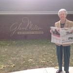Madge Adams, of Darlington, Pa., enjoys her Farm and Dairy newspaper outside the Glenn Miller Birthplace Museum, in Clarinda, Iowa. Clarinda is the birthplace of Adams, as well as Glenn Miller. Each year the town hosts the Glenn Miller Festival, attracting thousands, including the Glenn Miller Orchestra itself!