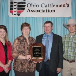Peggy and Tim Brinkman, along with their children Emily and Kyle, were honored as this year's Seedstock Producer of the Year. The Brinkmans operate Missing Rail Simmentals near Holgate,