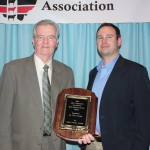 Ohio's state veterinarian, Dr. Tony Forshey (left), received the Industry Service Award, sponsored by the Ohio Cattlemen's Association and Ohio's Country Journal, represented by Editor Matt Reese.