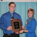 Christian Hoffman, of Stoutsville, Fairfield County, received the Ohio Cattlemen's Association Commercial Cattleman of the Year award. Presenting the award for Farm and Dairy is Editor Susan Crowell.