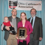 Allan Robison, pictured with wife Kelly and son, Noah, received the Young Cattleman of the Year award, sponsored by Ohio Farmer, represented by Editor Tim White (right). Robison farms near Mingo in Champaign County.