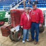 Photo of couple in front of a tractor