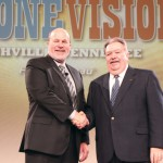 Pennsylvania Farm Bureau President Carl Shaffer (right) receives congratulations from American Farm Bureau Federation President Bob Stallman, as PFB won Awards for Excellence in all five program areas during AFBF's 94th annual meeting in Nashville.