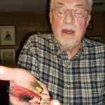 """(Mike Tontimonia photo)Artist and """"outdoors guy"""" Kevan Crouse is never done creating. An avid fly fisherman, Crouse holds a pair of traditional poppers that he made, modeled after hand-crafted bass lures of 100 years ago."""