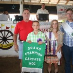 Cole Birkhimer's grand champion carcass hog, weighing 251 pounds, sold for $7 a pound to Paris Washington Insurance, represented by Kelly Palmer.