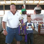 Case Farms, represented by Chuck Sluss, paid $600 for the grand champion pen of market poultry raised by Isaac Ricketts.