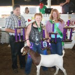 Alissa Baer, who also won grand champion goat project honors, sold her 79-pound grand champion market goat for $3.75 a pound to Lisbon Sav-A Lot Food Store, represented by Rick Stacy. Also pictured is Holly Baer, Columbiana County meat goat ambassador.