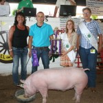 Mikey Estock's 271-pound grand champion market hog sold for $22 a pound to MAC Trailer, represented by Jenny Conny.
