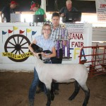 Margaret McNicol's 154-pound grand champion market lamb sold for $5 a pound to Rick Stacy of Lisbon Sav-A-Lot Food Store.