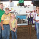 Claire Barrick's grand champion market rabbit pen sold for $450 to Buckeye Boiler, represented by Melanie Wanchick, and Ellie and Kesston Wanchick.
