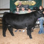 Kyla Sharp sold her 1,351-pound grand champion steer for $5.25 to Salem & Columbiana Chrysler Jeep Dodge, represented by John Kufleitner and Tanner (right) and Tucker Kufleitner. (Farm and Dairy photo, Salem, Ohio)