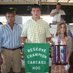 Harrison Hoppel raised this year's reserve champion carcass hog weighing 268 pounds. West Point Paving, represented by Mike Hoppel, paid $4.25 a pound for the pig.