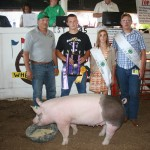 Jacob Smith's reserve champion hog weighing 270 pounds sold for $3.75 a pound to Hanover Farms, represented by Neil Zehentbauer. Also pictured are fair royalty Melinda Richey and Curtis Veiock.