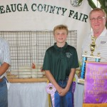 Dennis Bergansky raised this year's grand champion pen of meat chickens, which sold for $70/pound to Reserve Energy, represented by Joe Haas. The pen weighed 37.16 pounds.