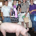Alyse Zemba raised this year's grand champion market hog. Her 270-pound champion sold for $38 a pound to Etna Products Inc., represented by Ike Tripp and his granddaughter, Maryanne Golden.