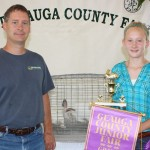 Sarah Grinstead sold her grand champion pen of meat rabbits, weighing 13.77 pounds, for $75 a pound to Geauga Feed and Grain Supply, represented by Kevin O'Reilly.