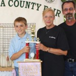 Dominic Dragolich's reserve champion pen of meat chickens, which weighed, 34.19 pounds, sold for $24 a pound to Nemec Farms, represented by Colleen and Dave Nemec.