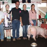 Christina Praetzel's 273-pound reserve champion hog sold for $10 a pound to Dave and Colleen Nemec of Nemec Farms.