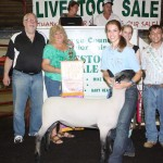 Jennifer Montazzoli raised the reserve champion market lamb, weighing 148 pounds. Green Family Funeral Home, represented by Dave Green and Karen Boyle, paid $17 a pound for the champion.