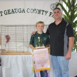 Dennis Bergansky's reserve champion turkey, weighing 47 pounds, sold for $22.50 a pound to Great Lakes Outdoor Supply, represented by Ralph Spidalieri.