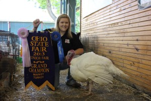 (Katie Fisher photo) Kaci Carter, from Cadiz, Ohio, is the first Harrison County youth to raise and show a grand champion at the Ohio State Fair. And as a show of support for the junior at Harrison Central High School, local businesses and even the county commissioners pooled their dollars to pay a record $13,000 for her grand champion turkey at Sunday's Sale of Champions.