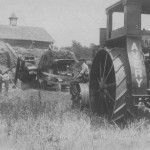 (Photo courtesy Walter Berg)Walter Baughman was a custom tractor operator in Richland County, Ohio.Here, Baughman is sitting on the front wheel of his tractor.