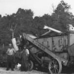 (Submitted by Jay Haines)Harold O. Haines (left) and his brother-in-law Roscoe Elliot get ready for a threshing run with a 1928 Huber Super Four tractor. This photo was taken in the summer of 1940.