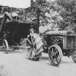 (Submitted by Thomas Downing)The late Lee Brown, of Perry Township, in Lawrence Co., Pa. leaves his home farm at the top of the hill, on what is now Armstrong Road. He's driving a Fordson tractor and towing a wooden Frick thresher. This photo is estimated to have been taken in the 1920s.