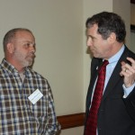 U.S. Sen. Sherrod Brown (right) talks to Clermont County farmer Roger Winemiller during the Ohio Farmers Union annual meeting Jan. 31.