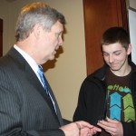 """During his visit to the Ohio Farmers Union annual meeting, U.S. Secretary of Agriculture Tom Vilsack quietly presented David Herman of Williams County with a """"challenge coin."""" Vilsack told Herman to keep the coin with him at all times and if """"challenged"""" or asked for it, Herman has to be able to produce it, or owe the challenger a """"milkshake,"""" Vilsack explained. The idea has its roots in military challenge coins."""