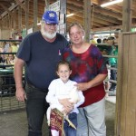 Alexis Messina's pen of grand champion chickens sold to Paul and Paula Hyde, of Hyde's Automotive, for $625, which set a Summit County Junior Fair record.
