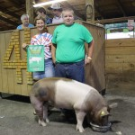 The $9.25 per pound bid by the Marhofer Auto Family, represented by Nancy Marhofer, for Cody Luther's 284-pound grand champion hog set a new Summit County Fair record.