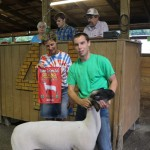 Nancy Marhofer, of the Marhofer Auto Family, bought Josh Conger's 128-pound grand champion lamb for $6.25 a pound.