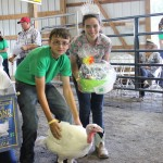 Corey Soulek's 25-pound grand champion turkey sold to Tom Emmett, of Emmett Equipment, for $675.  Also pictured, 2014 Summit County Junior Fair Queen Emily Jenkins.