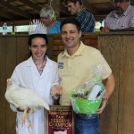 2014 Summit County Junior Fair Queen Emily Jenkins sold her pen of reserve champion chickens to state Rep. Anthony DeVitis for $500, a new fair record.