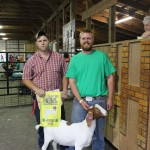 Mike Wells (left), of Dusk Till Dawn Farms in Streetsboro, Ohio, paid $175 for Brian Luther's 68-pound reserve champion goat.
