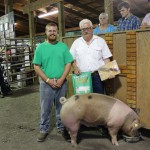 Brian Luther's 294-pound reserve champion hog sold to Tom Emmett, of Emmett Equipment, for $5.75 a pound.