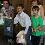 Nicholas Messina's reserve champion turkey was purchased by the Wotowiec family, represented by Marilyn Wotowiec and her grandson, Dylan.  Also pictured is 2014 Summit County Junior Fair Queen Emily Jenkins (left).