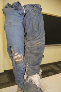 The difference between chain saw chaps (right) and no chaps (left).