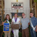 James H. Brown (right) bid $220 for Michaela Darby's best of show goat cheese basket.