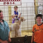 Mike and Bobbie Tramte bid $3 a pound for Jael Michelson's grand champion and best of show market goat.