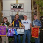 Lynn Gruber bid $22 a pound for Rebecca Dillon's 13.32-pound pen of grand champion and reserve best of show rabbits.