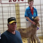 Garhett Smith's 64-pound reserve best of show market goat received a bid of $5 a pound from George Smith.