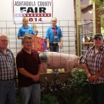 Representatives from the Ashtabula County Farm Bureau and the Ashtabula County Soil & Water District bid $4.60 a pound for Madisyn Gabriel's 241-pound reserve best of show market hog.  Pictured from left are farm bureau member Nate Lamoreaux, soil and water district representative Nathan Paskey, and Tom Spencer Jr. from the farm bureau.