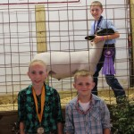 Alaina (left) and Zane Neczeborenko represented their aunt, Tricia Woods of Oink Moo Cluck Farms, who bought Daniel Jackam's 129-pound reserve best of show lamb for $7.00 a pound.