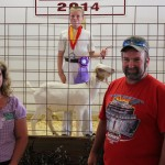 Elisha Michelson's 55-pound reserve champion market goat fetched a $3.50 a pound bid from Scott and Sara Johnson of Johnson Farms.