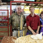 Matt Piechuta's grand champion chicken pen went to Hartville Kitchen for a bid of $1,500.  Pictured with Matt Piechuta is Hartville Kitchen representative Vernon Sommers.